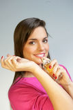 Woman applying perfurme on her wrist Royalty Free Stock Photography