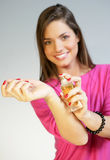 Woman applying perfurme on her wrist Royalty Free Stock Photos