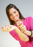 Woman applying perfurme on her wrist Royalty Free Stock Image