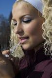 Woman applying pink lipstick Royalty Free Stock Photo