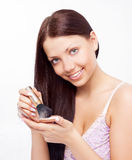 Woman applying powder Royalty Free Stock Photos