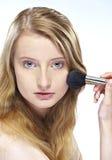 Woman applying powder Royalty Free Stock Photo