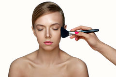 Woman applying Powder Foundation with Brush. stock images