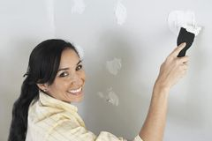 Woman Applying Putty On Wall Stock Images
