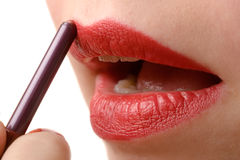 Woman applying red lipstick Stock Image