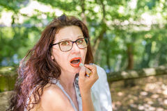 Woman applying red lipstick Royalty Free Stock Image