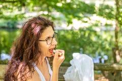 Woman applying red lipstick Royalty Free Stock Photos