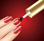 Woman applying red nail polish Stock Image