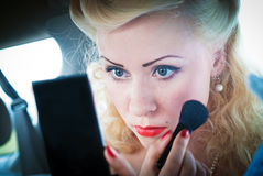 Woman applying rouge Royalty Free Stock Image