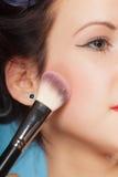 Woman applying rouge blush makeup Royalty Free Stock Image