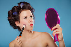 Woman applying rouge blush makeup Royalty Free Stock Photos
