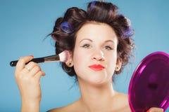 Woman applying rouge blush makeup Royalty Free Stock Photography
