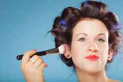 Woman applying rouge blush makeup Royalty Free Stock Photo
