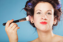 Woman applying rouge blush makeup Royalty Free Stock Images