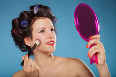 Woman applying rouge blush makeup Stock Photo