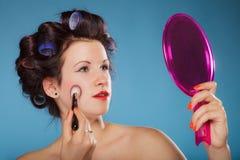 Woman applying rouge blush makeup Stock Image