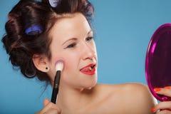 Woman applying rouge blush makeup Stock Photo