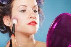 Woman applying rouge blush makeup Stock Images