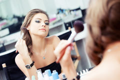 Woman applying rouge / powder Royalty Free Stock Images