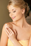 Woman applying skin creme Royalty Free Stock Photos