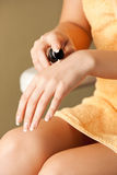 Woman applying skin creme to hands Stock Images