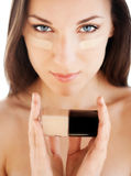 Woman applying skin foundation Royalty Free Stock Images