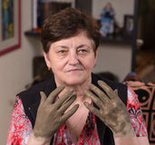 Woman applying spa cosmetic clay cream Stock Images