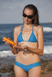 Woman applying sun cream Royalty Free Stock Images