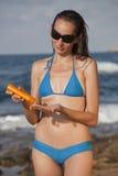 Woman Applying Sun Cream Royalty Free Stock Images