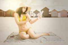 Woman applying sun cream at seashore Royalty Free Stock Image