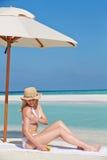 Woman Applying Sun Lotion On Beach Holiday Stock Photos