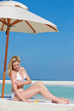 Woman Applying Sun Lotion On Beach Holiday Royalty Free Stock Image