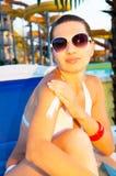 Woman applying sun protection Stock Photo