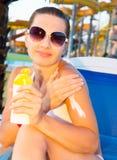 Woman applying sun protection Stock Photos