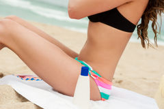 Woman applying sun protection lotion. Stock Photo