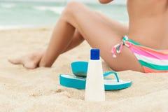Woman applying sun protection lotion. Royalty Free Stock Photo