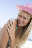 Woman applying sun protection product Stock Images
