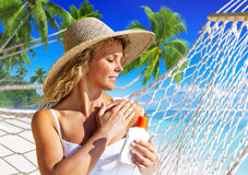 Woman Applying Sun Protection On skin Concept Stock Image