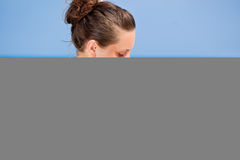 A woman is applying sunblock Royalty Free Stock Photos