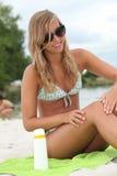 Woman applying sunblock. To prevent sunburn Stock Photo