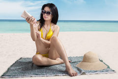 Woman applying sunscreen Royalty Free Stock Photo