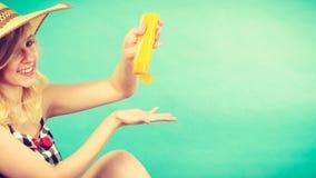 Woman applying sunscreen on hand Stock Photography