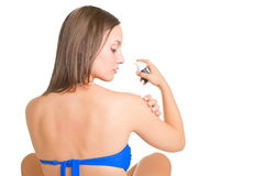 Woman applying sunscreen Royalty Free Stock Image