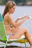 Woman applying sunscreen lotion Royalty Free Stock Photo