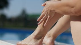 Woman Applying Sunscreen Lotion On Body stock video footage