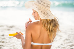 Woman applying sunscreen. On a sunny day Stock Photo
