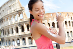 Woman applying sunscreen suntan lotion, Colosseum Stock Photos