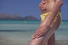 Woman applying suntan cream Royalty Free Stock Photo