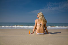 Woman applying suntan lotion Royalty Free Stock Images