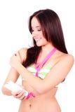 Woman applying suntan lotion isolated Stock Image